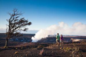 Couple walking along Halemaumau Crater