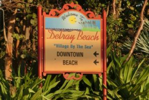 Village By the Sea Downtown Delray Sign