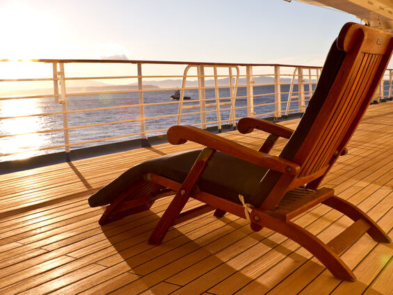 Wooden-lounge-chair-on-the-deck-of-a-cruise-ship-157558621_3867x2578