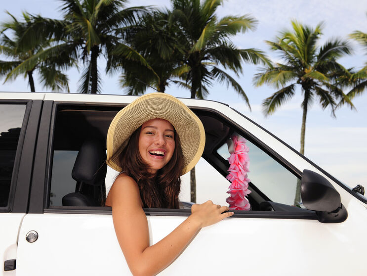 car-rental_-happy-woman-on-summer-vacation-104459324_3866x2577